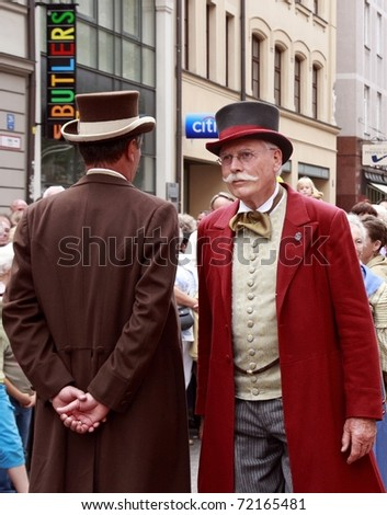 MUNICH - JULY 20:  actors dressed as english butlers near to the shop Butlers at the annual masquerade on July 20, 2008 in Munich, Germany