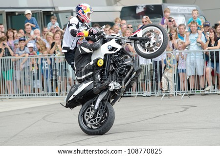MUNICH - JULY 28: Chris Pfeiffer, streetbike and freestyle rider, at the two wheel days on the BMW Welt in Munich on July 28, 2012. - stock photo