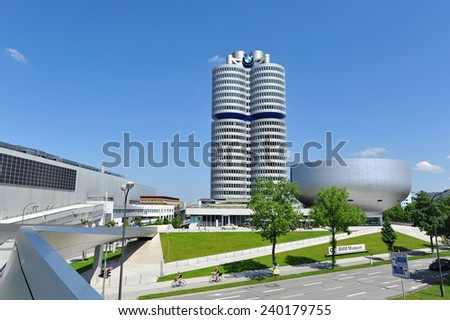 MUNICH - JUNE 8: Facade of BMW Museum and headquarters across a busy expressway on June 8, 2013 in Munich - stock photo