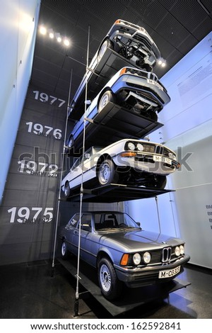 MUNICH - JUNE 8: Old BMW 745i, 633CSi, 520 and 323i on display in BMW Museum on June 8, 2013 in Munich - stock photo