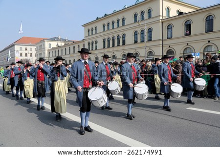 MUNICH - MARCH 15: irish bagpipers march at St. Patrick's day on March 15, 2015 in Munich, Germany. This national Irish holiday takes place annually in March in Dublin and other European cities. - stock photo
