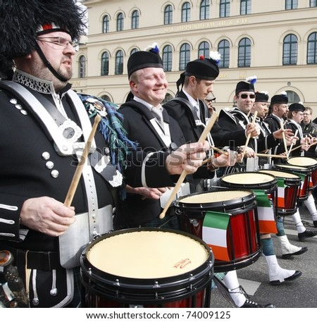 MUNICH - MARCH 13: irish drummers marches at the St. Patrick's day on March 13, 2011 in Munich, Germany. This national irish holiday takes place annually in March in Dublin and other european cities. - stock photo