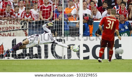 MUNICH, MAY 19 - Cech of Chelsea (L) saves the penalty of  Schweinsteiger during FC Bayern Munich vs. Chelsea FC UEFA Champions League Final game at Allianz Arena on May 19, 2012 in Munich, Germany. - stock photo