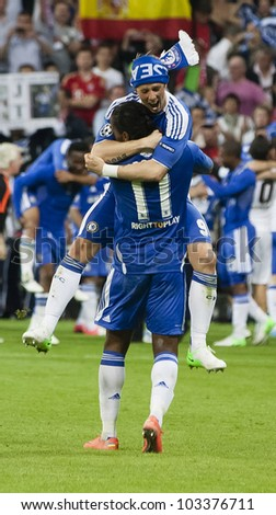 MUNICH-MAY 19 :Celebration of Chelse's win: Drogba (11) and Torres after FC Bayern Munich vs. Chelsea FC UEFA Champions League Final game at Allianz Arena on May 19, 2012 in Munich, Germany. - stock photo