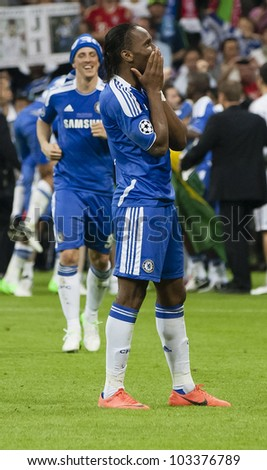 MUNICH-MAY 19 :Celebration of Chelsea's win: Drogba (R) and Torres after FC Bayern Munich vs. Chelsea FC UEFA Champions League Final game at Allianz Arena on May 19, 2012 in Munich, Germany. - stock photo