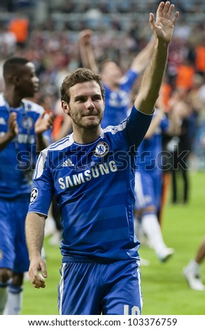 MUNICH-MAY 19 :Celebration of Chelsea's win: Juan Mata after FC Bayern Munich vs. Chelsea FC UEFA Champions League Final game at Allianz Arena on May 19, 2012 in Munich, Germany. - stock photo