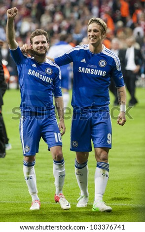 MUNICH-MAY 19 :Celebration of Chelsea's win: Mata (L) and Torres after FC Bayern Munich vs. Chelsea FC UEFA Champions League Final game at Allianz Arena on May 19, 2012 in Munich, Germany. - stock photo