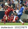 MUNICH, MAY 19 - Drogba of Chelsea (R) and Tymoshchuk of Bayern during FC Bayern Munich vs. Chelsea FC UEFA Champions League Final game at Allianz Arena on May 19, 2012 in Munich, Germany. - stock photo