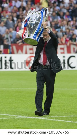 MUNICH-MAY 19 : German football legend Paul Breitner with the Cup before FC Bayern Munich vs. Chelsea FC UEFA Champions League Final game at Allianz Arena on May 19, 2012 in Munich, Germany. - stock photo