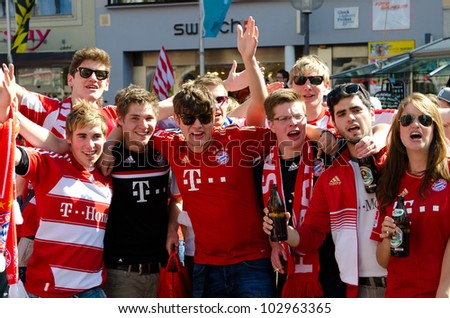 MUNICH - MAY 19: Thousands of fans celebrate in central Munich on the Marienplatz before the UEFA Champions League final football match between FC Bayern Muenchen and Chelsea FC on May 19, 2012 - stock photo