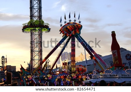 MUNICH - OCT 4: Fairground rides at night at Oktoberfest in Munich, Germany on October 4, 2010 - stock photo
