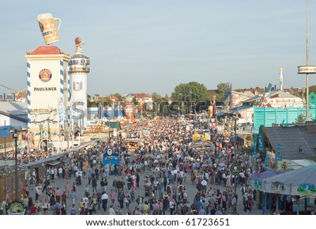 MUNICH – SEPT 22: Crowds of visitors at the annual Oktoberfest celebrating its 200th anniversary in Munich on Sept 22, 2010.  The Festival runs from Sept 18 - Oct 4 and is expecting 6 million guests. - stock photo