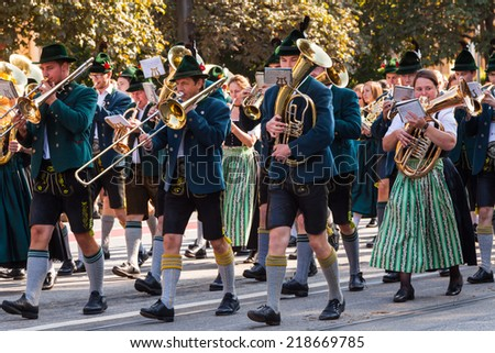 MUNICH - SEPTEMBER 21: Adorned thoroughbred horses at the costume and Riflemen's Parade during the Oktoberfest in Munich, Germany on September 21, 2014. - stock photo