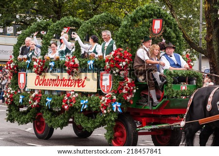 MUNICH - SEPTEMBER 20: horse carriage takes part into Oktoberfest solemn procession September 20, 2014 in Munich, Bavaria, Germany. Oktoberfest is annually beer festival. - stock photo