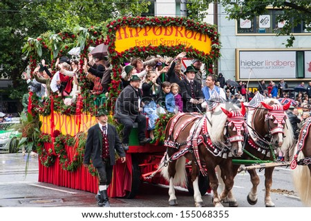 MUNICH - SEPTEMBER 21: Opening of Oktoberfest September 21, 2013 in Munich, Germany. Horse carriage takes part into Oktoberfest solemn procession.