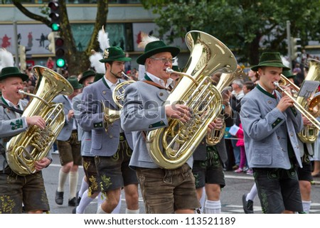 MUNICH - SEPTEMBER 22: Opening of Oktoberfest September 22, 2012 in Munich, Germany. Musicians dressed in national costumes take part into Oktoberfest solemn procession.