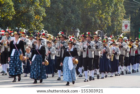 MUNICH - SEPTEMBER 22: Participants in a traditional bavarian costume at the Riflemen's Parade during the Oktoberfest in Munich, Germany on September 22, 2013.