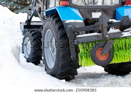 Municipal city equipment removing snow from the roads in winter after snowstorm - stock photo