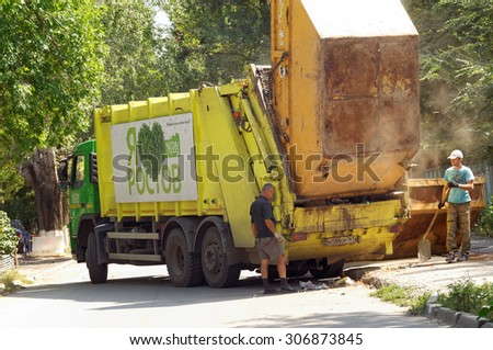 Municipal city service on cleaning of garbage. Rostov-on-Don, Russia. August 17, 2015