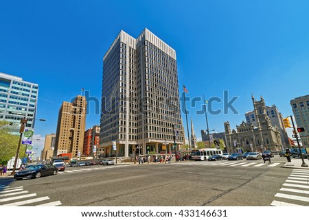 Municipal Services Building and skyscrapers in Philadelphia, Pennsylvania, USA. It is central business district in Philadelphia. Road view. Tourists in the street. - stock photo