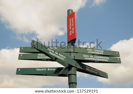 Municipal traditional directional signs for tourists in historical center of Brussels, Belgium - stock photo