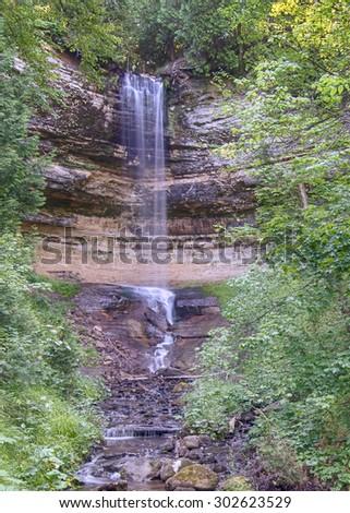 Munising Falls on Munising Creek, in Munising, Michigan. - stock photo