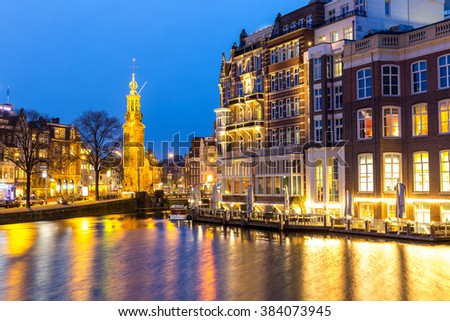 Munttoren Tower at Muntplein square Amsterdam Netherlands at dusk