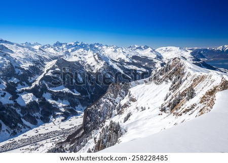 Muotathal valley and Lake Lucerne surrounded by Swiss Alps seen from Hoch Ybrig ski resort, Schwyz, Central Switzerland - stock photo