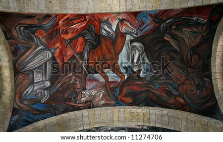 Mural by Clemente Orozco of Spanish Invasion, ceiling, Cabanas Cultural Institute, Guadalajara, Mexico.  Orozco painted this mural in the late 1930s and died in 1949. - stock photo