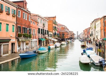 Murano island, Venice, Italy - November 10, 2014: Canal in Murano island, street and boats  - stock photo