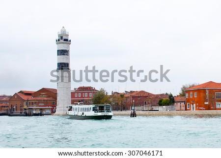 Murano Island, Venice, Italy - November 11, 2014: The lighthouse at the Murano Island near Venice Italy - stock photo