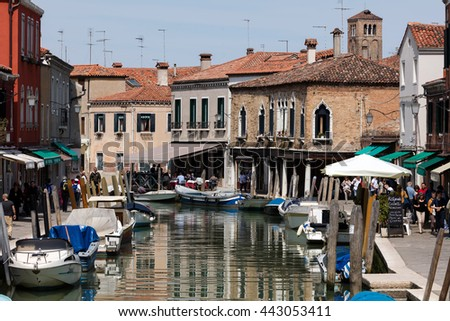 MURANO, ITALY - APRIL 30 2016: Murano is a series of islands linked by bridges in the Venetian Lagoon, northern Italy. It is famous for its glass making. - stock photo