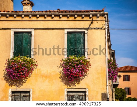 MURANO, ITALY - AUGUST 19, 2016: Famous architectural monuments and colorful facades of old medieval buildings close-up on August 19, 2016 in Murano, Italy.