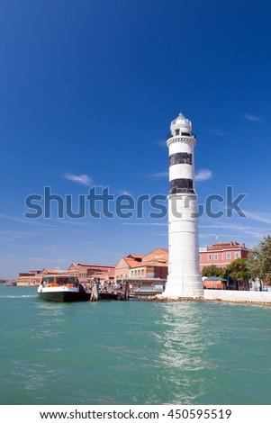 MURANO, ITALY - AUGUST 17, 2012. The lighthouse, Murano faro, Murano island, Venice, taken on August 17, 2012, in Murano. Landmark of Veneto region, Italy. - stock photo