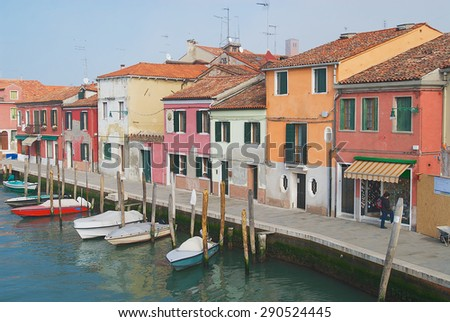 MURANO, ITALY - FEBRUARY 27, 2007: View to the channel, boats and buildings at the street in Murano, Italy. - stock photo