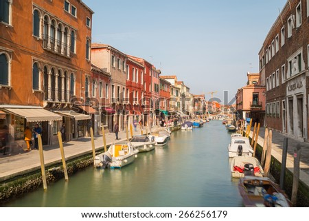 MURANO, ITALY - 14TH MARCH 2015: A view along Fondamenta Dei Vetrai footpath in Murano during the day, showing shops, boats, buildings and people - stock photo