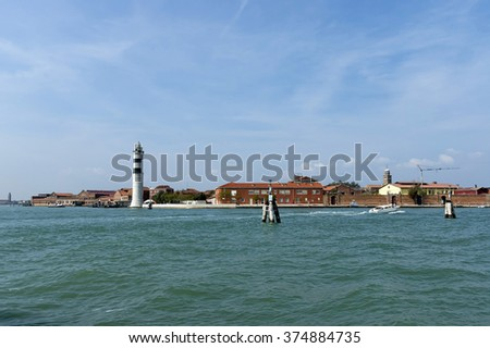 Murano, Venice, Italy - September 23, 2011: Murano island is the most famous place for handmade glass production by artisan glass-worker. Visit of ancient island Murano in autumn. - stock photo