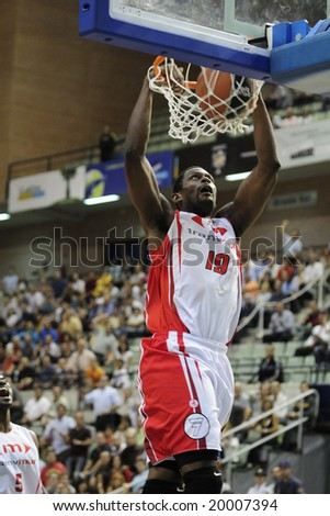 Murcia, Spain - October 10: Lamont Barnes of CB Murcia dunks the ball in the game against Regal FC Barcelona at Palacio de los Deportes on October 10, 2008 in Murcia, Spain