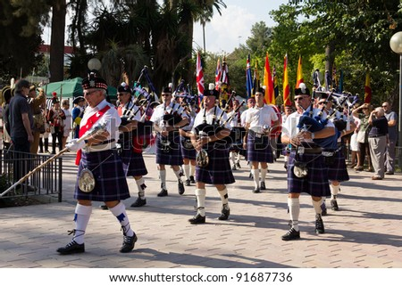 MURCIA, SPAIN - OCTOBER 16: Unidentified Scottish pipers in a military parade during historical reenactment of 1944 WWII battles on October 16, 2011 in Murcia, Spain.