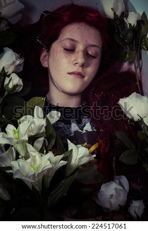 murder, young girl lying in water, romantic scene - stock photo