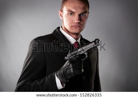 Murderer in black suit - stock photo