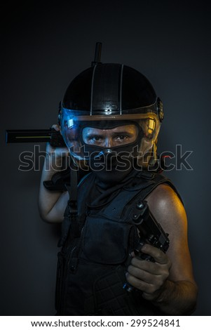 murderer with motorcycle helmet and guns