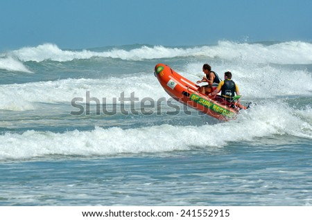 MURIWAI, NZL -  JAN 01 2015:New Zealand Lifeguards on duty.NZ has the 3rd highest drowning rate in the developed world.In 2013, 98 people drowned in New Zealand waters. - stock photo
