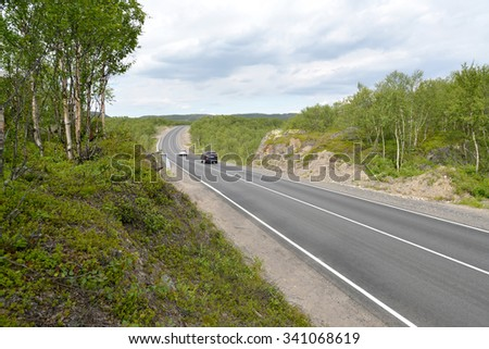 MURMANSK REGION, RUSSIA - JULY 18, 2015:  The highway A138 in the tundra
