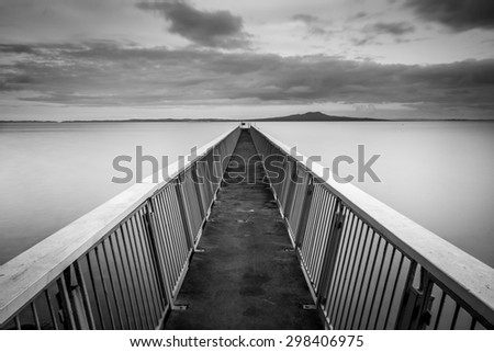 Murrays Bay Wharf & Rangitoto Island | Auckland, NEW ZEALAND - stock photo