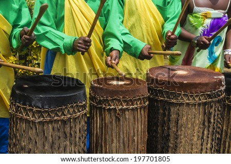 MUSANZE, RWANDA - NOVEMBER 5: Tribal Drummers of the Batwa Tribe Perform Traditional Intore Dance to Celebrate the Birth of an Endangered Mountain Gorilla on November 5, 2013 in Musanze, Rwanda. - stock photo