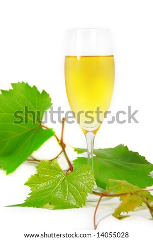 muscat glass of wine with leaves on white - stock photo
