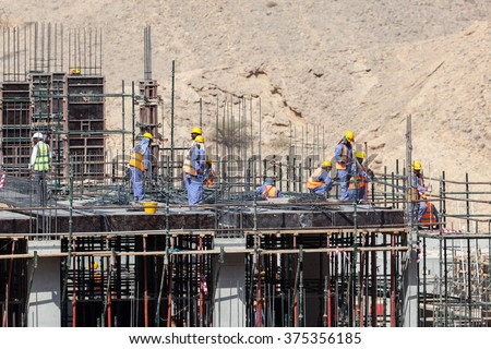 MUSCAT, OMAN - NOV 29, 2015: Concrete works at a construction site. Sultante of Oman, Middle East