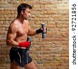 muscle boxer man with fist bandage and training weights - stock photo