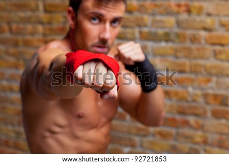 muscle boxer shaped man fist to camera - stock photo